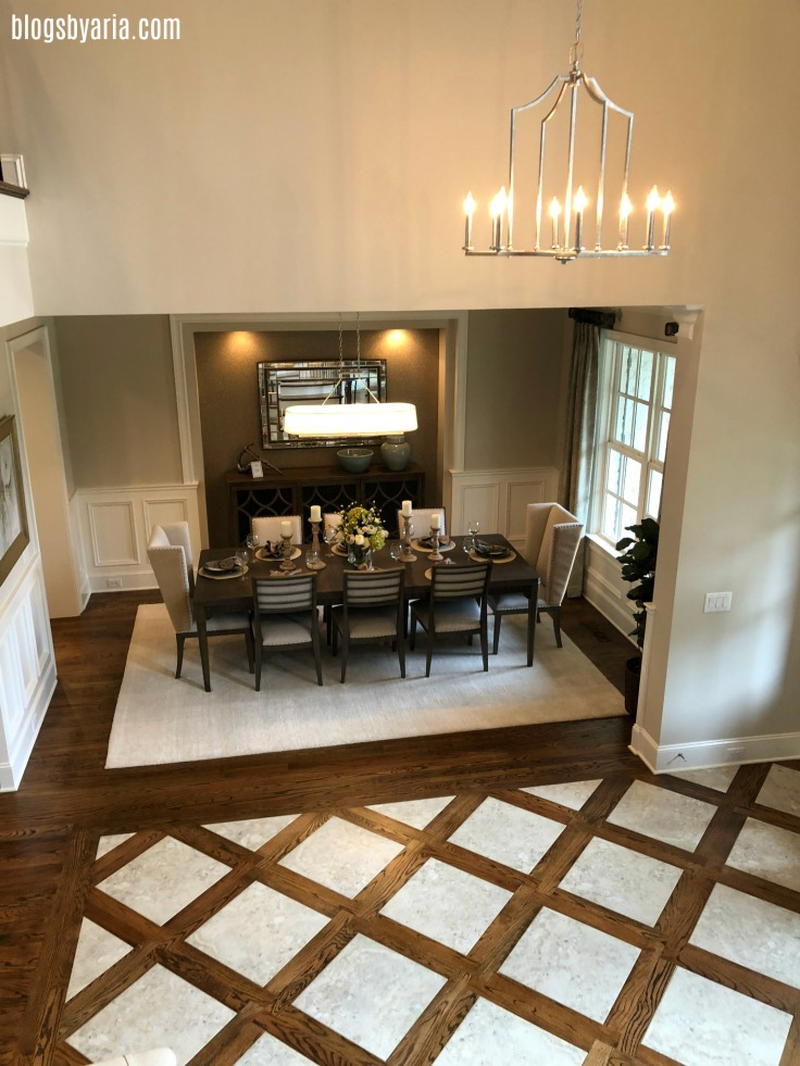 marble and hardwood floor foyer looking into formal dining room with lighted niche - interior design ideas