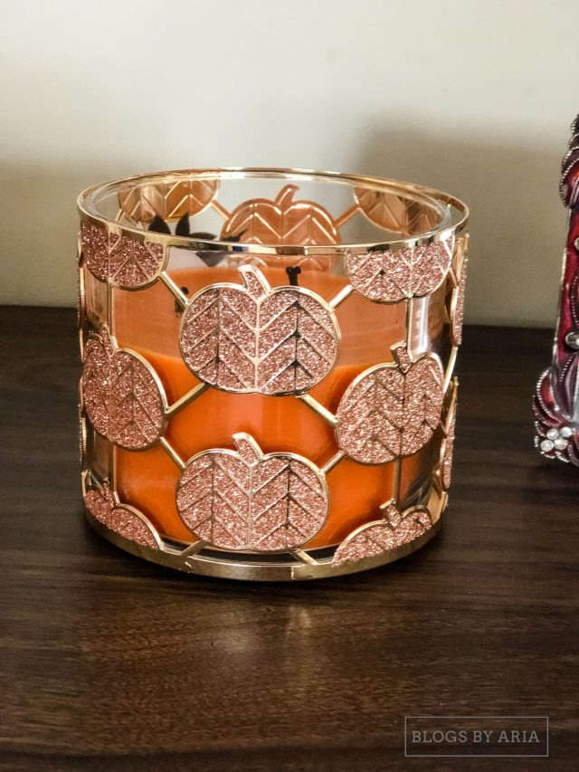 fall pumpkin scented candles are a must have to make your home feel cozy for fall