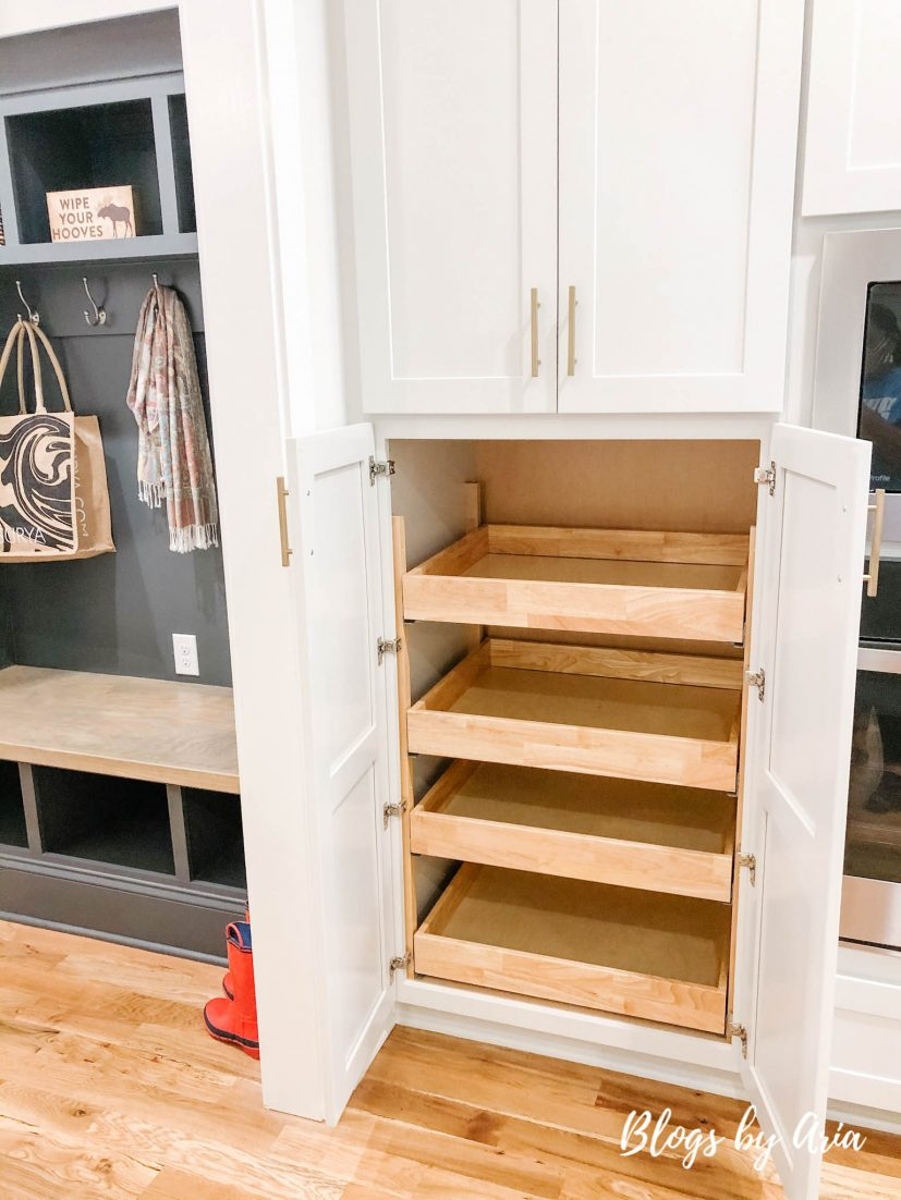 light gray kitchen with pull out drawers in pantry