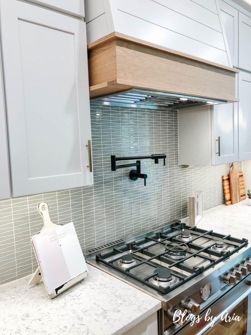kitchen with shiplap wood trimmed hood