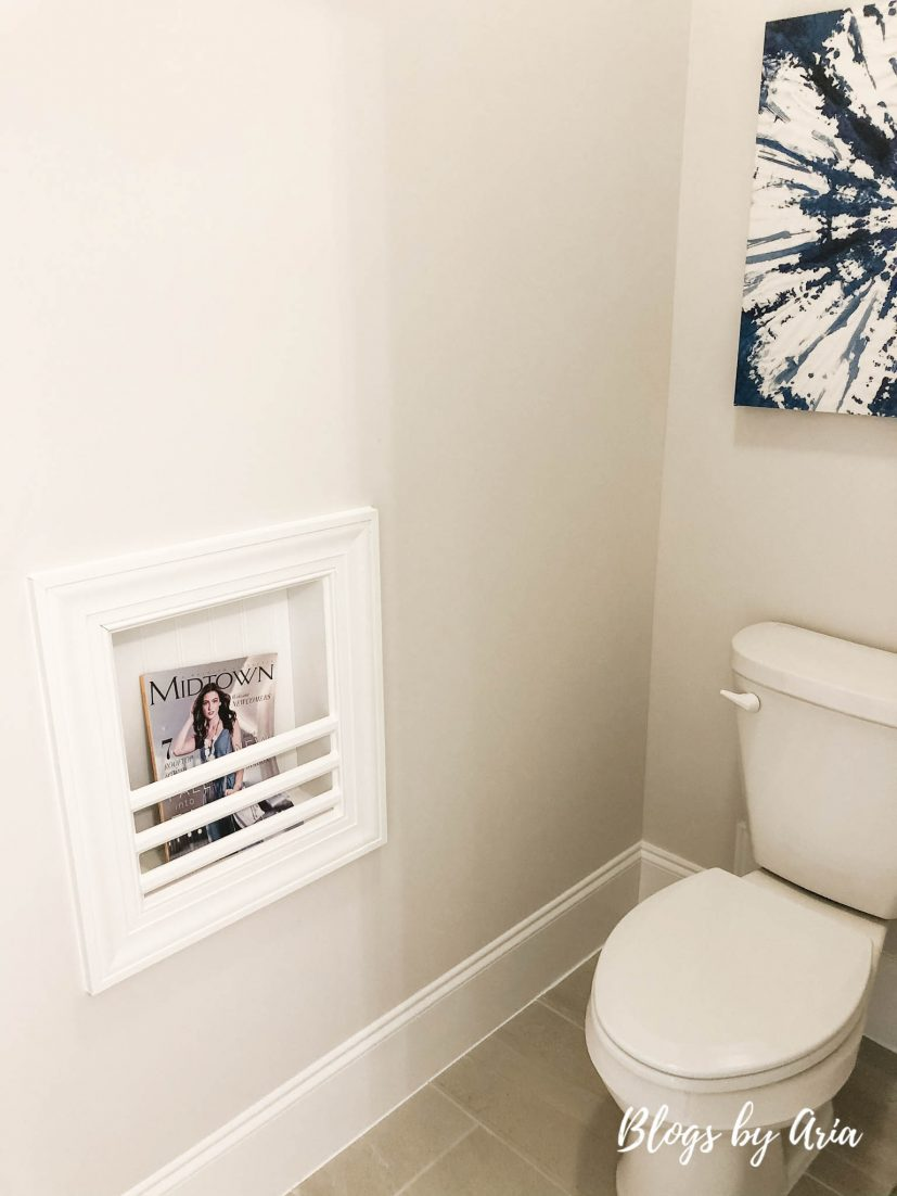 water closet with built in magazine rack