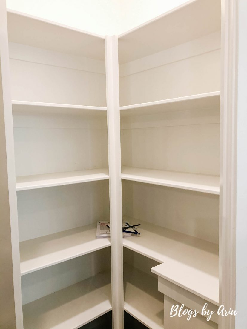 pantry with corner shelving