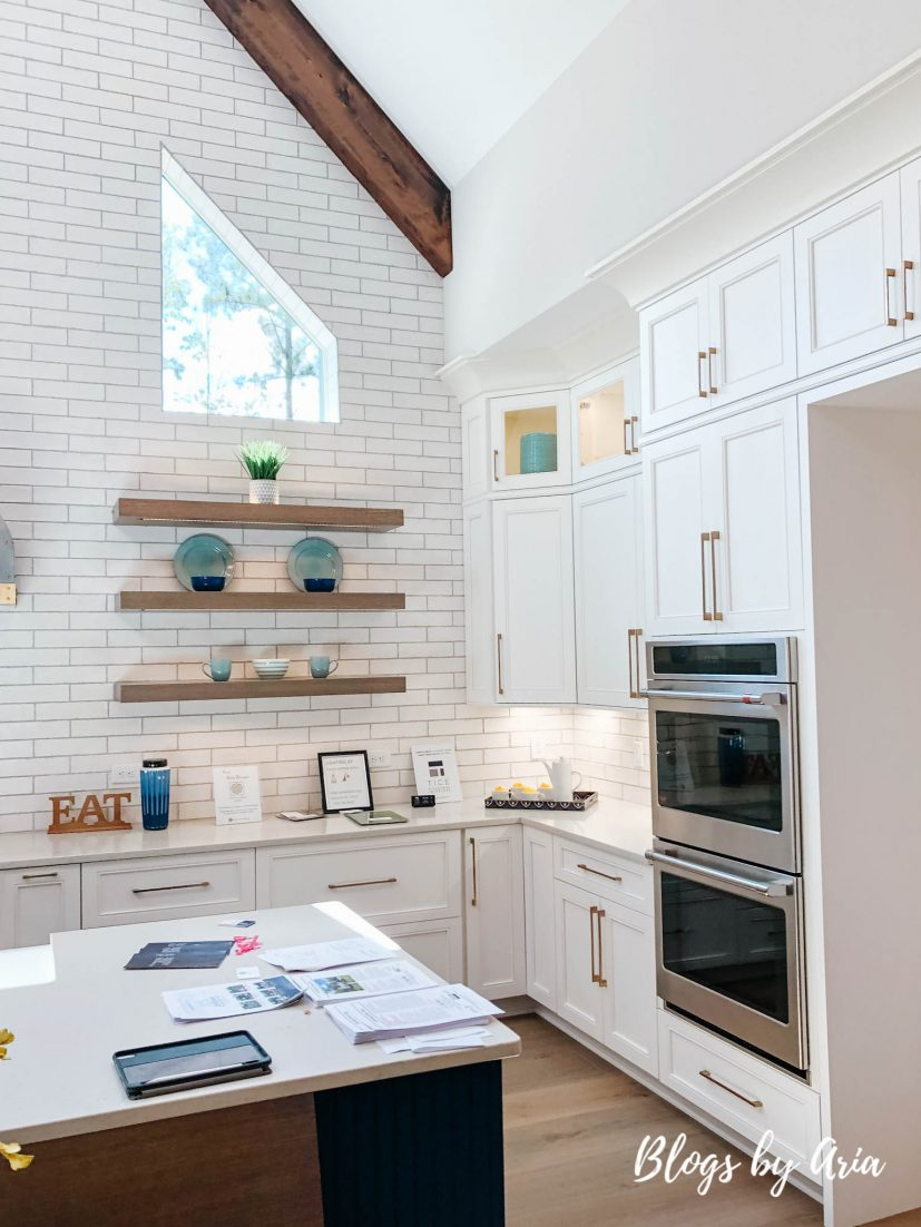 vaulted beam kitchen with floating shelves